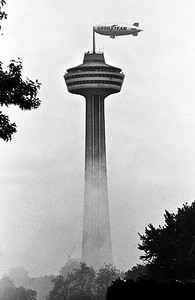 JUNE 21, 1989: The Goodyear Blimp, on a flyby through Niagara Falls, N.Y., and Ontario, appears to be moored to the Skylon tower in Niagara Falls, Ont. in this photo. The famous dirigible was on its way to a stop in Canada.