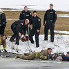 Niagara Falls firefighters pull a man from the freezing waters of Hyde Park Lake Wednesday as his loyal dogs look on, one even holding his glove. Witnesses told police 70-year-old Pascal Scrufari had been walking his three Golden Retriever dogs near the lake about 3 p.m. on February 15, 2012, when he ran out onto the lake after one of the dogs and fell through some thin ice.  Scrufari later died at Niagara Falls Memorial Medical Center leaving his dogs homeless and in the care of the SPCA of Niagara. Niagara Falls firefighters were quickly on the scene and pulled Scrufari out of the water.