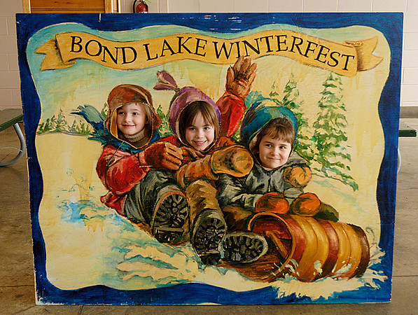 James Neiss/staff photographer<br /> Sanborn, NY - Olde Fashion Fun - Cute as a button could describe, from left,  Grace Rife, 5, Margaret Rife, 6 and Rachel Elledge, 5, all from Niagara Falls, who pose in a cutout for the Bond Lake Winterfest. The event, sponsored by the Bond Lake Environmental and Beautification Committee, featured food and fun for all.