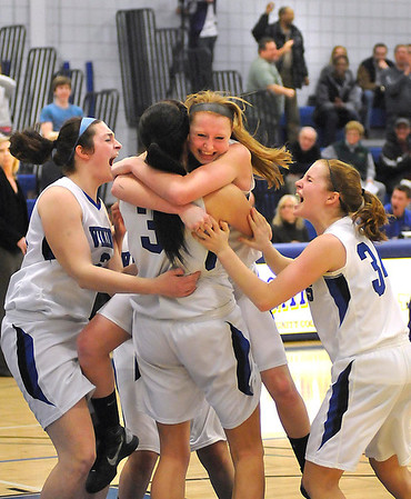 James Neiss/staff photographerSanborn, NY - Members of the Grand Island High School girls basketball team celebrate after scoring a basket that put them in the lead against Hamburg during the Class A-1 championship game at Niagara County Community Collage on Saturday.