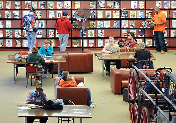 """The Public Library was a little extra busy today as schools take a spring break for two weeks. """"Busy Library"""""""