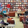 "The Public Library was a little extra busy today as schools take a spring break for two weeks. ""Busy Library"""