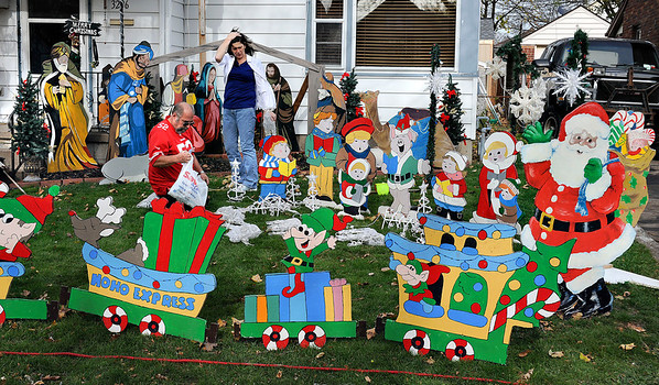 """James Neiss/staff photographerNiagara Falls, NY - OVER THE TOP: """"Go big or not at all,"""" may be the theme for John and Dawn Irace of South Avenue, who's Sunday project was to set up their hand-made Christmas decorations. The couple, said they have been building the collection for over 15 years and Sundays balmy weather was the perfect time to set it up. Furthermore, with all the talk about retailers getting a jump start on Christmas holiday sales earlier this year, some might appreciated that the couple said they will not turn on the power for the display until the day after Thanksgiving."""