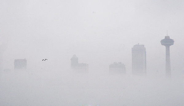 James Neiss/staff photographerNiagara Falls, NY - The fog made for an ethereal view of the Canadian skyline as seen from the Rainbow Bridge on Saturday.