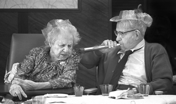 12/31/89 - Maurice Abbot gives his wife, Isabelle, a little toot to bring in 1990 during an afternoon New Year's Eve Party Sunday at the Fairchild Manor Nursing Home in Lewiston, where botha re residents.
