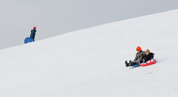 James Neiss/staff photographerNiagara Falls, NY -  Sledders enjoy the brisk, but sunny weather on the hills at Reservoir State Park on New Years day.