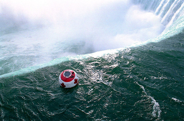 September 26, 1993: Canadian Daredevil Dave Munday became the first person to survive a second trip over Niagara Falls. Photo by James Neiss