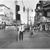 "Urban Renewal - Traffic Control Box<br /> Control Box is out of the Officer's reach.  Officer R. Wolfe standing under the box is 5' 11"" tall and can not reach the control box.<br /> Photo - By William Corcoran - 9/29/1953."