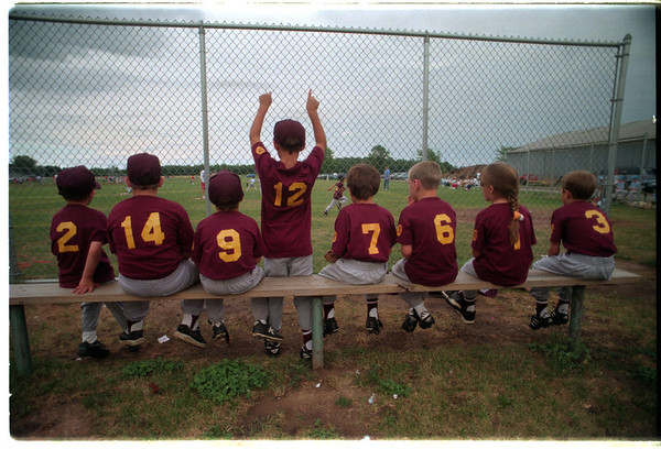 98/06/30 The Ol' Pepper 5 - James Neiss Photo - Reids Drive-In vs R.J.'s Ice Cream. #12 Evan Shugats 8yrs suddenly stands to cheer on a teem mate in the first inning.