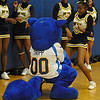 James Neiss/staff photographerNiagara Falls, NY - Doing the Thunderwolf Shuffle: Niagara Falls High School Cheerleader Lasharee Wallace busts a move with Tripp the Thunderwolf, Niagara County Community Collage's mascot. Tripp stopped by the high school to support NFHS during the 12th Annual Cataract City Classic 2011 basketball tournament.