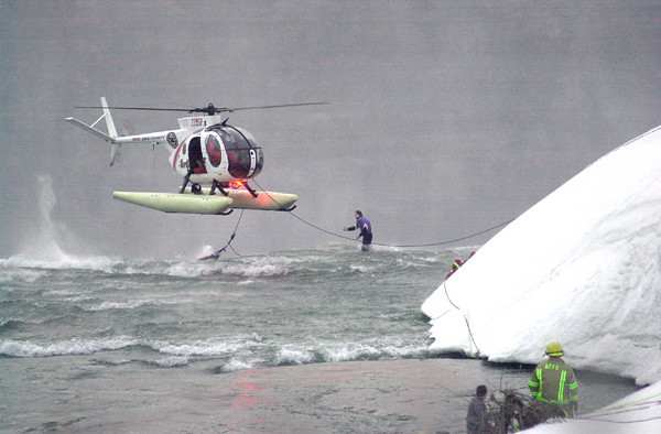 030319 Rescue 2/ James Neiss Photo/ Story/ NF - Erie County Sheriffs helicopter crew drops life ring and saves mans life at brink of the Horse Shoe Falls off Terrapin Point.