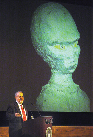 """050927 UFO Lecture - NG<br /> James Neiss/STAFF PHOTOGRAPHER<br /> Sanborn, NY - World-famous UFO expert Stanton T. Friedman lectures at Niagara County Community Collage in a talk entitled """"UFOs are real."""" The Nuclear Physicist-Lecturer covered 5 scientific studies, saucer landings, abductions, star travel, UFO origins, the recovery of crashed saucers near Roswell, New Mexico and proof that UFOs are a cosmic Watergate."""