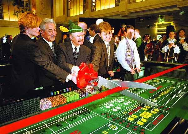 990407 Casino Dice 4 - James Neiss Photo - Ribbon Cutting - Casino Niagara kicks off legal dice gaming in Canada today. L-R - Debbie Zimmerman, Niagara Regional chairperson, Gary Pilliteri, MP, Mayor Wayne Thommson and MPP Bart Maves cut the ribbon kicking off Dice Games at Casino Niagara.