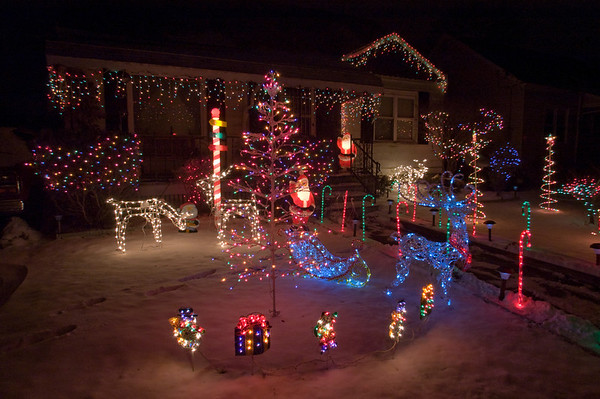 James Neiss/staff photographer<br /> Niagara Falls, NY - Michael Brown of 3553 Ferry Avenue shows off his Christmas spirit with a beautiful light display in his front yard.