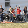 James Neiss/staff photographerLewiston, NY -  Members of the band Reperfection, from left, Jonathan Zeams, Shane Jacob, T.J. Carson on drums, Ryan Morreale and Patrick Tierney, enjoy a spring like day to rock it out of doors at a home on Ridge Road. The band was practicing for their next gig.