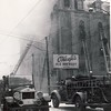 A fire at Dundas St. W. & Simcoe St. Some time in the 1940's from the vintage of the rigs.<br /> <br /> From the collection of Jon Lasiuk