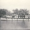 The Toronto fire boat Charles A. Reed at its island dock near the Manitou Rd. bridge on Centre Island in 1928. <br /> <br /> l. to r. Lt. A. Sargent, Bill Kennedy, Jason McCartney, S. Brooks, J. Ridout.<br /> <br /> From the collection of Jon Lasiuk