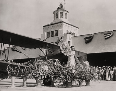 Actress Viola Peters at the dedication ceremony of Los Angeles Municipal Airport, June 7, 1930. Hangar #1, built by Curtis-Wright Co. is shown in the background. The structure was rededicated on December 20, 1990 after being restored by the AVIA Development Group for cargo and office use.