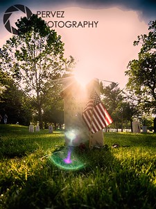 Got a sun flare at a soldier's grave (to cover up the name, which I don't want seen in a photo out of respect for whoever this soldier was and their family) in the late afternoon on Memorial Day at Arlington National Cemetery - a somber day, to be sure, but there is a heightened sense of respect and community as families and friends visit their loved ones. Also, there is a lot of effort made to put American flags on the graves, and I have to imagine the uniformity of that provides those who are missing their fallen some comfort.