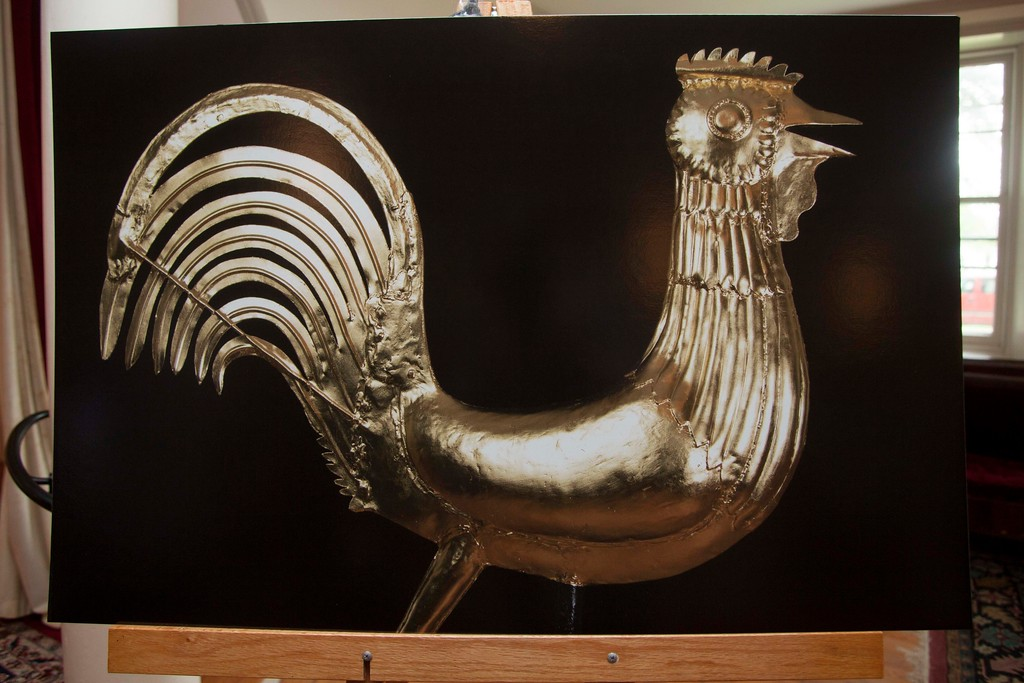 """. A detailed picture of \""""Buddy,\"""" the historic rooster-shaped weather vane that sits on top of the Old Groton Meetinghouse, presented in a display following the weather vane\'s re-installation on Saturday. Lowell Sun/Chris Lisinski"""