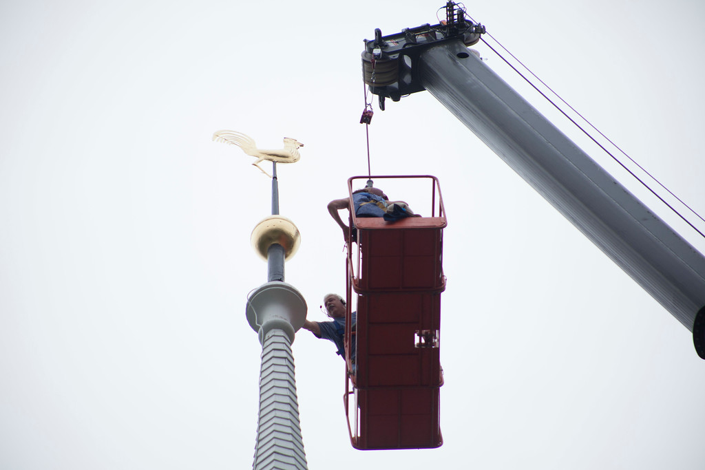 """. A 200-plus-year-old weather vane, shaped like a rooster and nicknamed \""""Buddy,\"""" sits on top of the Old Groton Meetinghouse after being re-installed Saturday. Lowell Sun/Chris Lisinski"""