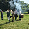 Members of the Billerica Colonia Minute Men demonstrate their muskets by firing a volley as part of the group's living history demonstration. Photo by Mary Leach