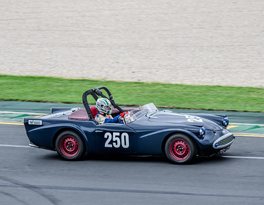 Digby Smith, number 250, driving a 1960 Daimler SP250