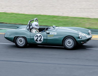 Ian McDonald, number 22, driving a 1960 Elva Courier