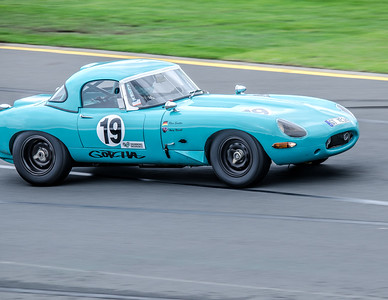 Rhea Sautter, number 19, diving a 1961 Jaguar E-Type