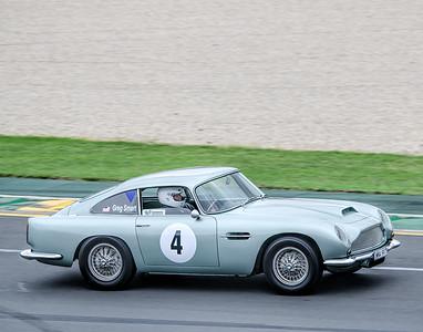 Greg Smart, number 4, driving an Aston Martin DB4 GT