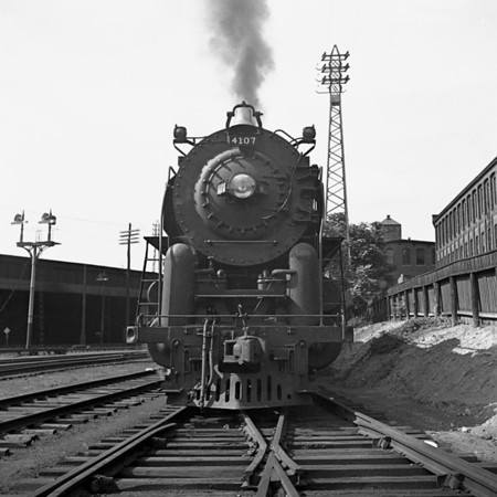 Worcester, MA, B&M #4107 on Jackson St. siding waiting to back down to train and go to Portland. 1940-14n2_dK