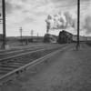 B&M East Deerfield, MA, westbound #4100 passes #4006. 1940-08n1_dK