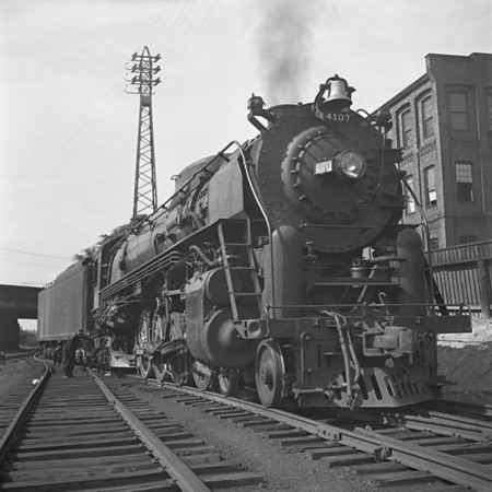 Worcester, MA, B&M #4107 on Jackson St. siding waiting to back down to train and go to Portland. 1940-14n1_dK