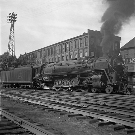 Worcester, MA, B&M #4107 on Jackson St. siding waiting to back down to train and go to Portland. 1940-14n3_dK