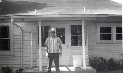 President R. Dudley Boyce in front of the Farmhouse/Administration Building