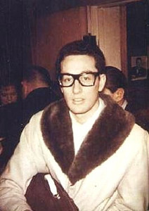 "Charles Hardin Holley, known professionally as Buddy Holly age 22, was an American singer-songwriter and a pioneer of rock and roll. The change of spelling of ""Holley"" to ""Holly"" came about because of an error in a contract he was asked to sign, listing him as Buddy Holly. That spelling was then adopted for his professional career.<br /> <br /> Although his success lasted only a year and a half before his death, Holly is described by critic Bruce Eder as ""the single most influential creative force in early rock and roll."" His works and innovations were copied by his contemporaries and later musicians, notably The Beatles and The Rolling Stones, and exerted a profound influence on popular music.<br /> <br /> This picture of Buddy Holly taken backstage at the Laramar Ballroom in Fort Dodge, Iowa on January 30, 1959 during the Winter Dance Party tour."