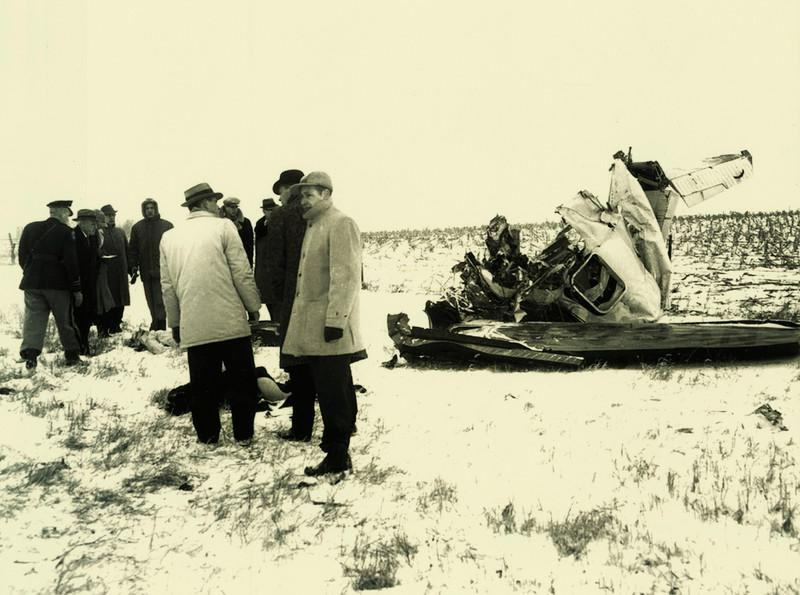 Authorities confer at the crash site.