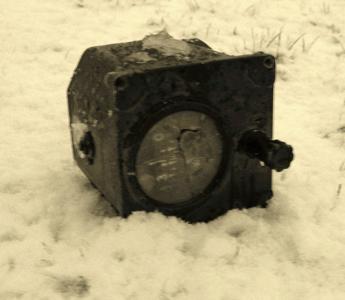 One of the aircraft's flight instruments (Gyro Compass Indicator) thrown from the plane during impact.
