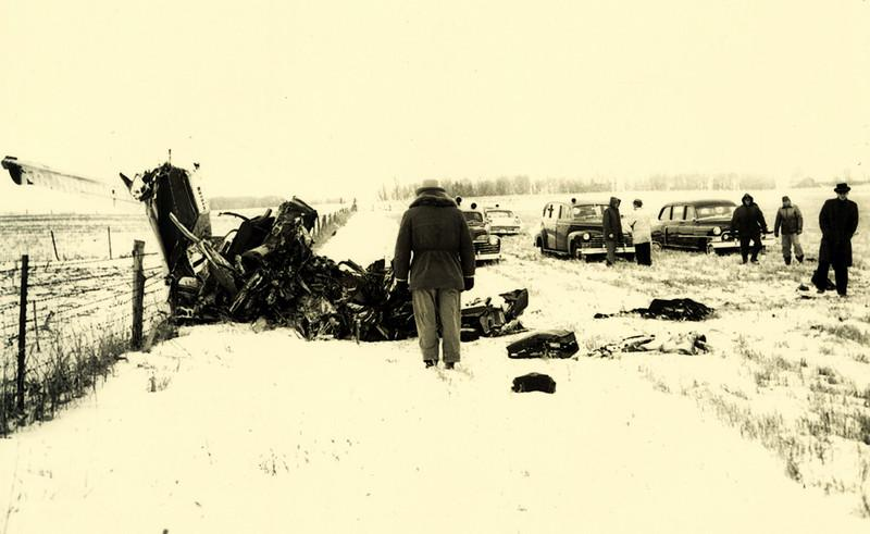 Jerry Dwyer discovered the wreckage at 5:30 am. Newsmen and others gathered at the crash site, about 5 miles northwest of Clear Lake, but all were barred until acting coroner Dr. Ralph Smiley arrived at 11:30. The three passengers had been thrown from the plane. Snow, which fell lightly after the crash, had drifted slightly about the bodies and wreckage. Some parts of each body had been frozen by ten hours' exposure in temperature reported to have been near 18 degrees.