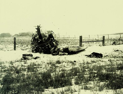Two bodies were located near the main wreckage and can be seen in this photo. The one on the left is that of Buddy Holly and the one on the right is Ritchie Valens.