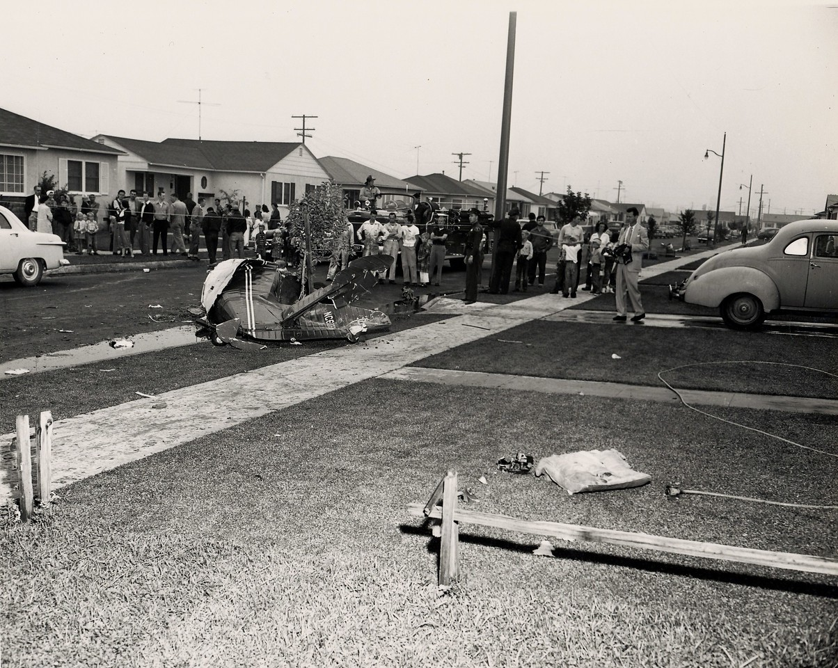 The Stinson's fuselage, minus the wings tumbled onto the curb nearly 400 feet from the first point of impact.