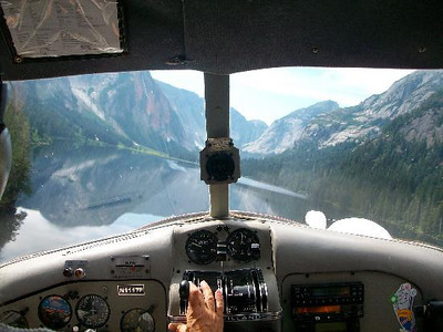 "The flight continued along the preplanned flight route, towards a shallow mountain pass known to local tour pilots as ""the cut."" <br /> <br /> The first pilot said that after passing through the cut he encountered low clouds, rain and fog, with a visibility of 2 to 3 miles. He said that he was able to maintain VFR flight conditions by descending to about 700 feet over an ocean fjord."