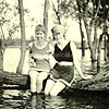 Two women sitting on a log in swimsuits at Lake Tahoe, California in 1922