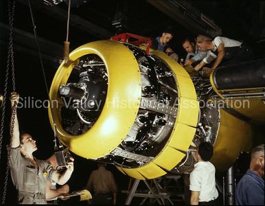 Workers at a plant in Inglewood, California mounting a motor on a Fairfax B-25 Bomber