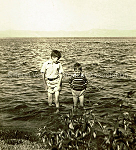Two children wading in Lake Tahoe, 1938