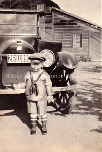 Young boy in front of standing in front of a Model A Ford in Santa Clara, California c. 1918