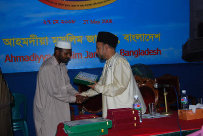 Hashem Ullah Sikder 2nd Prize winner among Khuddam in Essay Competition receiving Prize from National Ameer sb.