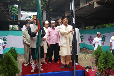 Flag hoisting by National Ameer Mubasher ur Rahman sb and Afzal Ahmad Khadem Ameer sb Dhaka