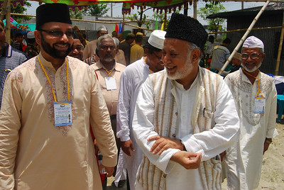 National Ameer Mobasher ur Rahman (L) was received by Sadr Ansarullah Ahmad Tabshir Choudhury (R) on his arrival