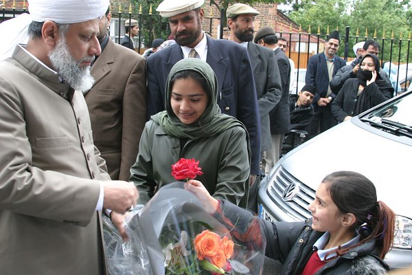 A Nasira presenting flower to Beloved Huzur